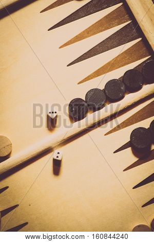 Backgammon board with dice shot from above.