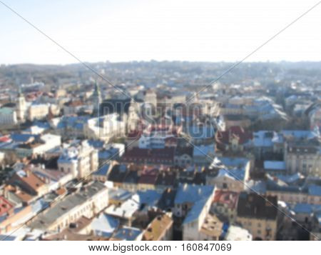 Old town panorama from tower. Blurred photo of Lviv Ukraine. Lviv historical city center view in blur. Old Europe urban landscape. Romantic rooftop image.
