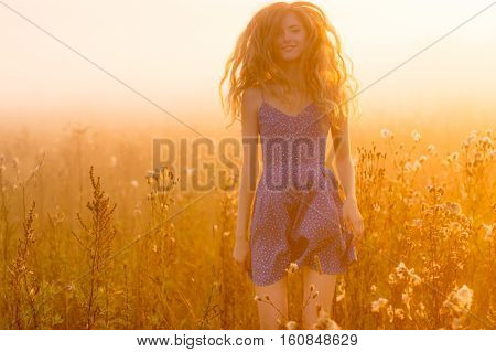 Jumping And Smiling Beautiful Girl In Fog