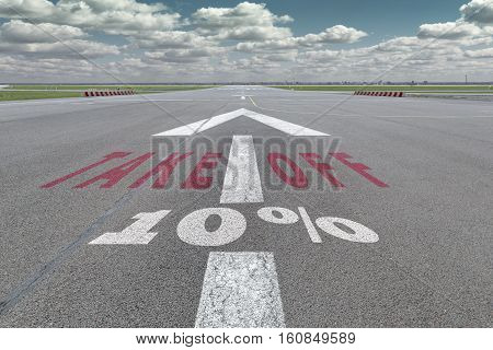 Runway of airport with arrow guideline take off and 10 percent sign printed on the asphalt