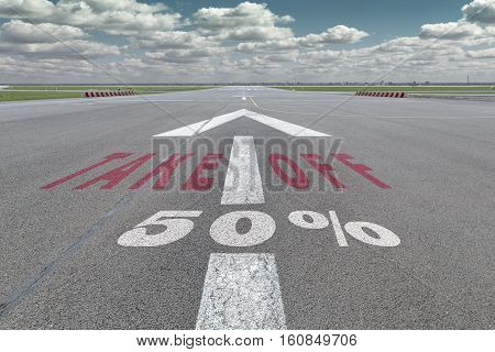 Runway of airport with arrow guideline take off and 50 percent sign printed on the asphalt