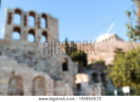 Old building architectural remains of Acropolis blurry image. Ancient arcs blurred photo background for historical and cultural travel White stone ancient building of Acropolis in Athens Greece