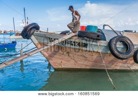 GEORGETOWN, MALAYSIA - NOVEMBER 3, 2008: Fisherman in the chinese village of Georgetown, Malaysia