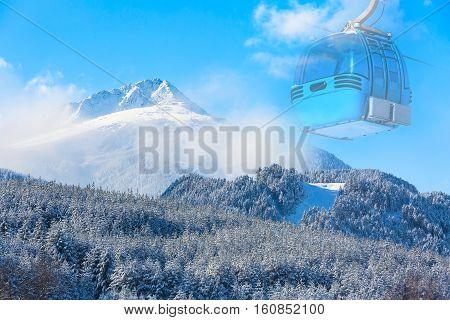 Winter travel ski resort background with cable car cabin, ski slopes, snow mountain peak