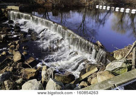 Waterfall below South County Bike Trail along Saugatucket River in Wakefield Rhode Island