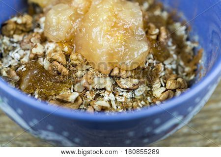 Bowl Of Muesli Cereal Topped With Applesauce