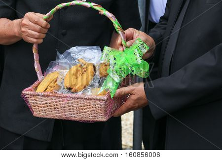 Hand of giving banana basket gift for health in day Christmas and New Year