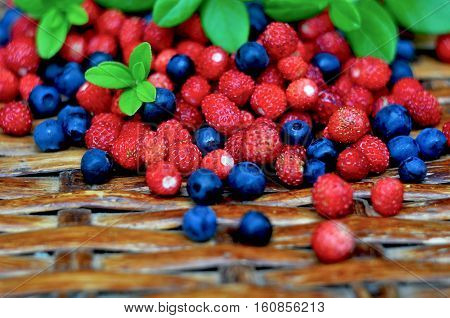 wild strawberry and bilberry against a wattled basket