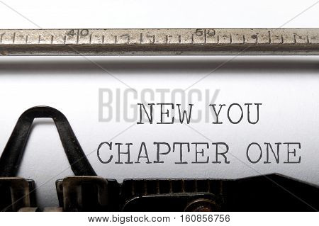 New you chapter one printed on an old typewriter