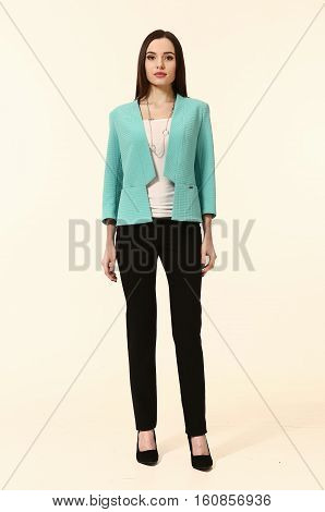 woman with straight hair style in blue jacket skirt suit black trousers full body portrait isolated on white