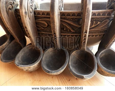 Wooden Bratina with small buckets. Bratina - a vessel for drinking. Folk craft. Russia. Closeup.
