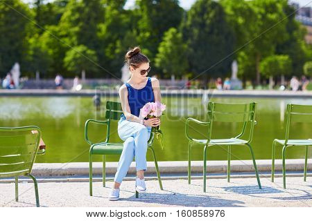 Young Parisian Woman Of Pink Peonies In Tuileries