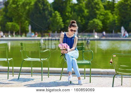 Beautiful Young Parisian Woman With Peonies