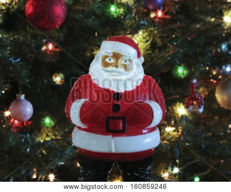A Vintage 1950s Light Up Glitter Santa Claus in Front of a Christmas Tree