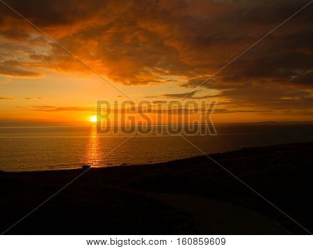 beautiful orange sunset at Nant Gwrtheyrn, Wales
