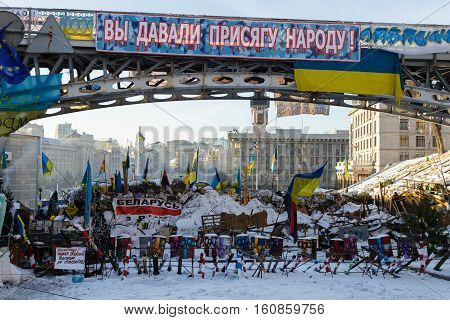 Kiev, Ukraine - February, 2014 - The barricades of tires, barrels, sand and iron against the police during the Maidan at the Independence Square in Kiev, Ukraine at winter day.