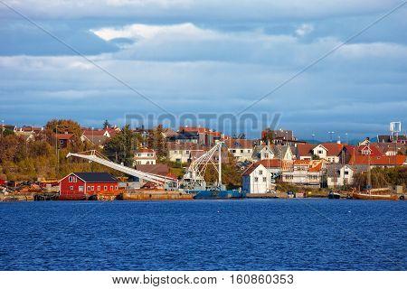 Small fishing harbor in Stavanger Norway .