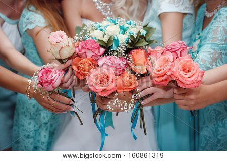 Close up of bride and bridesmaids bouquets, hands