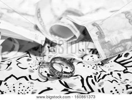 Wedding rings and russian money, love and happy