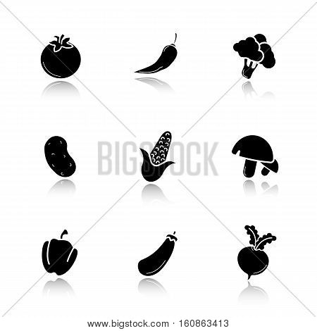 Vegetables drop shadow black icons set. Tomato, hot chili pepper, broccoli, potato, corn, mushrooms, beetroot, paprika, eggplant, maize, turnip. Isolated vector illustrations