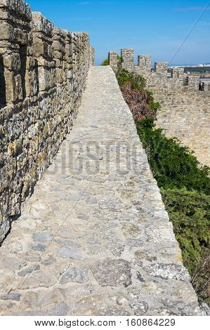 Fortified wall of city Obidos in Portugal