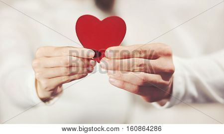 Couple hands holding Heart shape love symbol Valentines Day romantic greeting people man and woman relationship lifestyle feelings concept