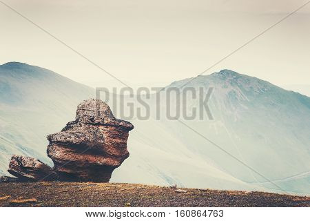 Minimalistic Landscape of rock stone and mountains on background Travel serene scenic view