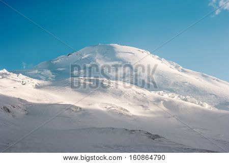 Elbrus Mountain summit glacier Landscape Travel serene scenic view blue sky