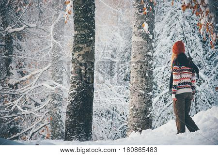 Woman walking alone in winter forest Travel Lifestyle adventure concept vacations into the wild