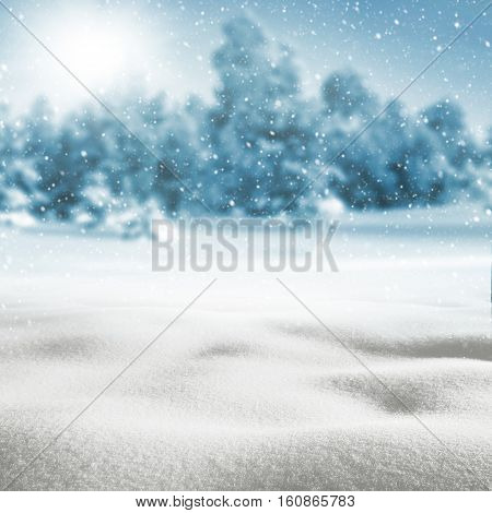Winter background with snow drifts and snow-covered forest