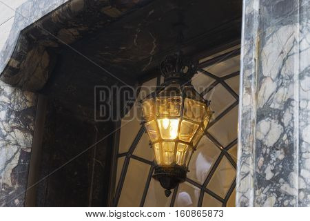 artistic lamp in glas and wrought iron