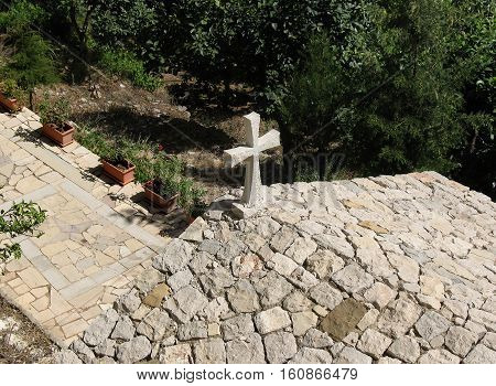 A view of an old, stone church with a crucifix, from above. Lebanon.