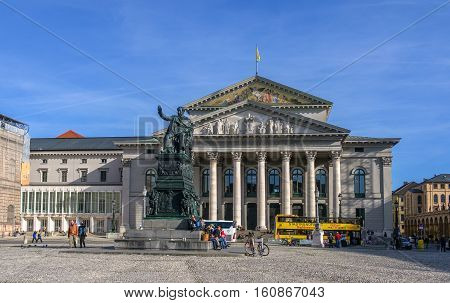 Munich, Germany - October 16, 2011: National Theater Munich - Bavarian State Opera. In the foreground monument to King Maximilian I of Bavaria Joseph.