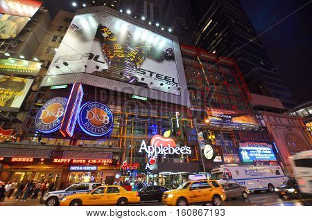 NEW YORK CITY - OCT 2, 2011: Theater District near Times Square at night on 42th street, Manhattan, New York City, USA.