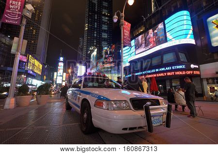 NEW YORK CITY - OCT. 2, 2011: NYPD police car in Times Square at night, Manhattan in New York City, USA.