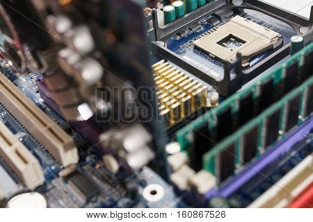 Close-up shot of high performance personal computer. Processor into the motherboard socket. Computer hardware, selective focus