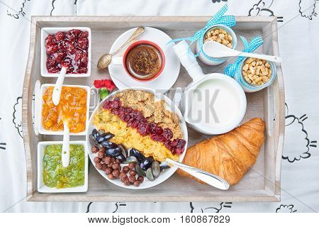 French breakfast on a wooden tray. Breakfast in bed