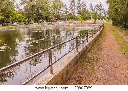 Stainless balustrade or fence surrounding pond for protection of rain water for consumption