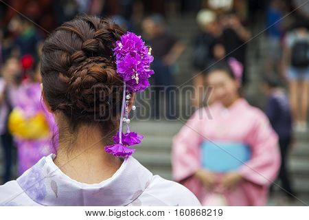 TOKYO, JAPAN - OCTOBER 3, 2016: Unidentified woman at Sensoji temple in Askusa Tokyo. It is Tokyo oldest and one of most significant temples