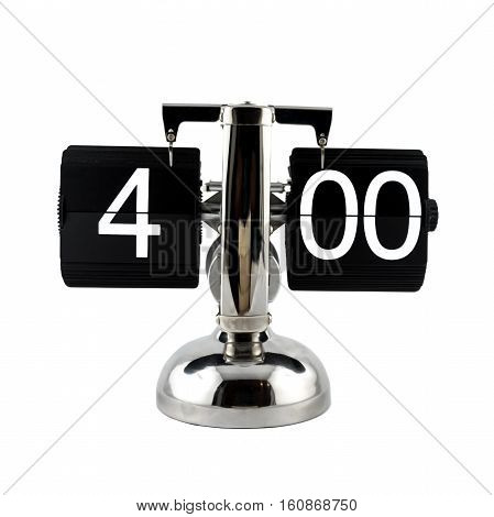 Isolated vintage flip clock at four o'clock on white background