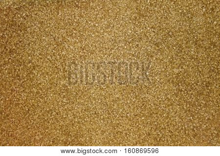 Brown raw sugar background. Close up. Top view