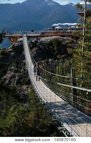 Squamish BC Canada - Sept. 22 2016: The Sea to Sky Gondola ride the Summit Viewing Deck and Sky Pilot Suspension Bridge are exhilirating experiences in the shadow of Sky Pilot Mountain peaks.
