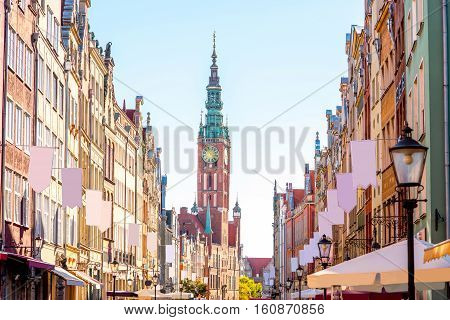 Morning view on the central street with town hall in the old town of Gdansk, Poland