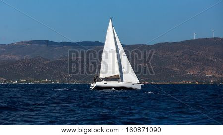 Sailing boat at regatta. Yachting in the wind through the waves at the Sea.