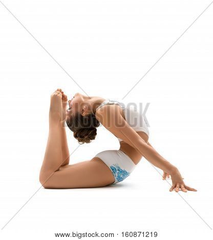 Beautiful  female gymnast stretching and exercising , isolated on white background. Young athletic woman in bright leotard practicing in gymnastics