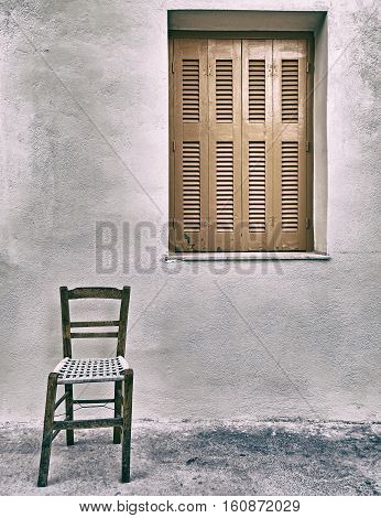 nobody is here chair and closed shutters window