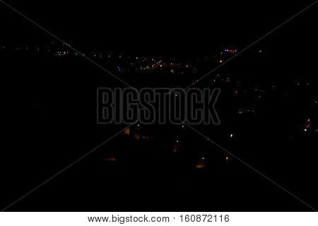 A small Lebanese village at night with lights.