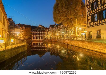 Petit France medieval district of Strasbourg illuminated at night, Alsace France