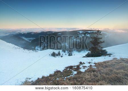 winter foggy morning on mountain top Feldberg Germany