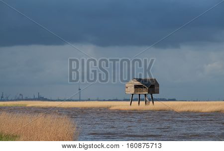 wooden tower on Wadden sea coast Netherlands